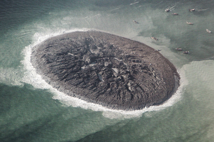 Close-up of the new island, estimated to stretch 75 to 90 meters (250 to 300 feet) across and standing 15 to 20 meters (60 to 70 feet) above the water line. The surface is a mixture of mud, fine sand, and solid rock. Image via NASA Earth Observatory via National Institute of Oceanography.