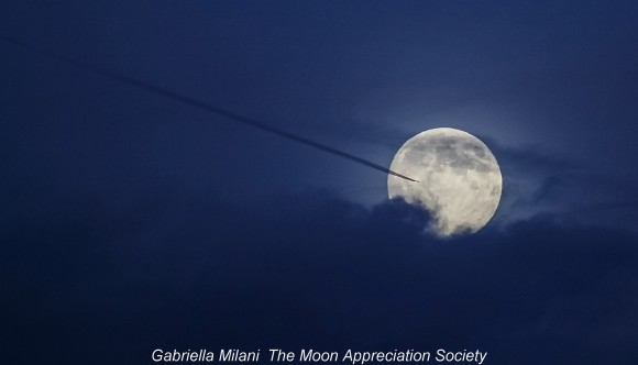 Harvest Moon and plane on September 18, 2013 by Gabriella Milani of the Moon Appreciation Society.