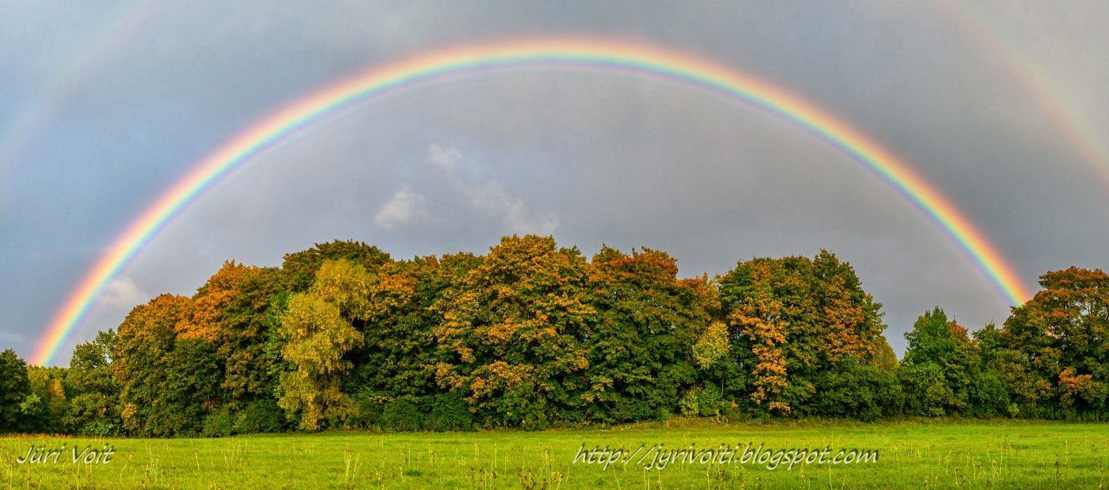 View larger. | Double wonders: double rainbow and autumn leaves.  Photo by Juri Voit of Estonia.