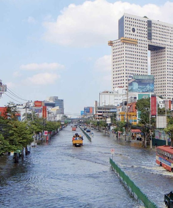 Roads in the North Bangkok Business District are submerged in floodwaters in November 2011 after heavy rains during the annual monsoon season.  The Thailand flood of 2011 cost the insurance industry USD 15 billion, the largest insured fresh water flood loss ever.