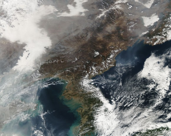 The light, gray colors are showing the smog across parts of Northeast China on Tuesday, October 22, 2013. Image Credit: NASA