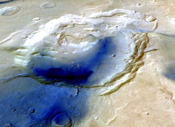 In this image, the dark color indicates younger material draped across the Eden Patera depression. Image credit: ESA