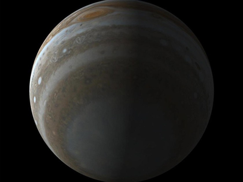 View larger. | Here's a simulated view of the south pole of Jupiter, as it will be seen by the Juno spacecraft in 2016. This simulation illustrates the unique perspective of the Juno mission. The spacecraft's polar orbit will allow Junocam to image Jupiter's clouds from a vantage point never accessed by other spacecraft. Junocam has a 58-degree-wide field of view encompassing the entire polar region. The view illustrated here simulates an image taken 40 minutes before Juno's closest approach to Jupiter. At closest approach, Junocam's images of Jupiter's cloud tops will have a resolution better than 5 kilometers per pixel. Image via NASA / JPL / MSSS via the Planetary Society.