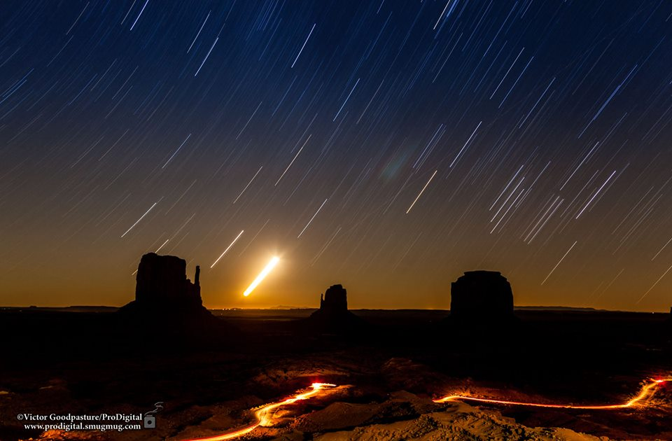 View larger. | Star trails over Monument Valley on September 27, 2013 from Victor Goodpasture.  The bright object is the moon.  Thank you, Victor!