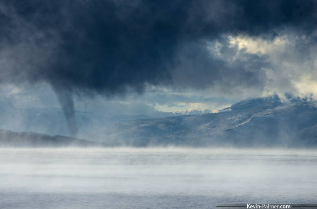 View larger. | A steam devil hangs over Yellowstone Lake, Wyoming. This lake is the largest body of water in Yellowstone National Park and the largest freshwater lake above 7,000 feet (2,133 meters) in North America. Photo via Kevin Palmer Photography.