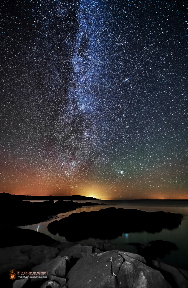 View larger. | Central starry pathway is the Milky Way, our home galaxy. The Andromeda galaxy is an elongation fuzzy patch, just right of center. Photo copyright Mike Taylor of Taylor Photography.
