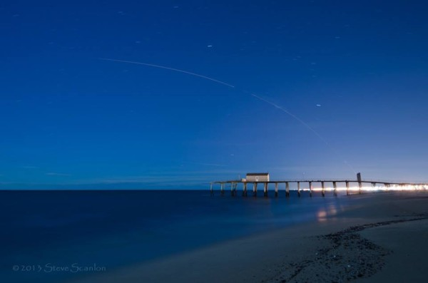 Steve Scanlon caught the launch from Belmar, N.J. The Belmar Fishing Pier is in the foreground. Visit Steve Scanlon Photography.