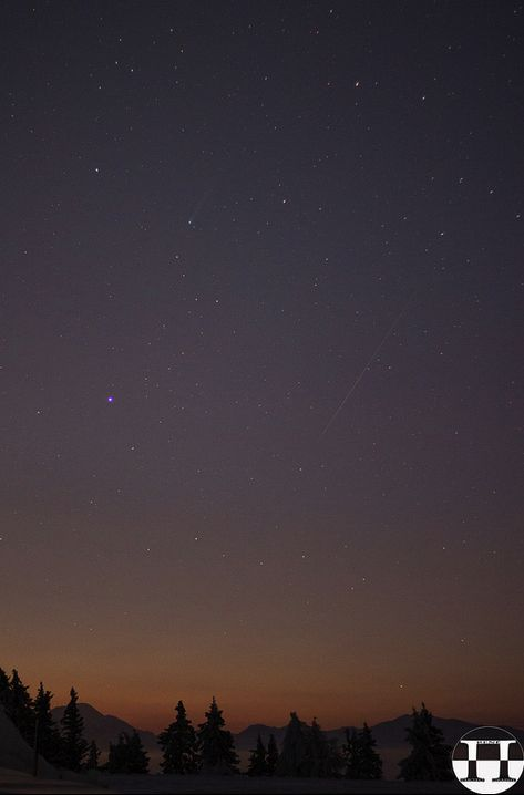 View larger. | Rene Pi BSC caught this amazing image of Comet ISON (greenish streak at top) with a Leonid meteor.