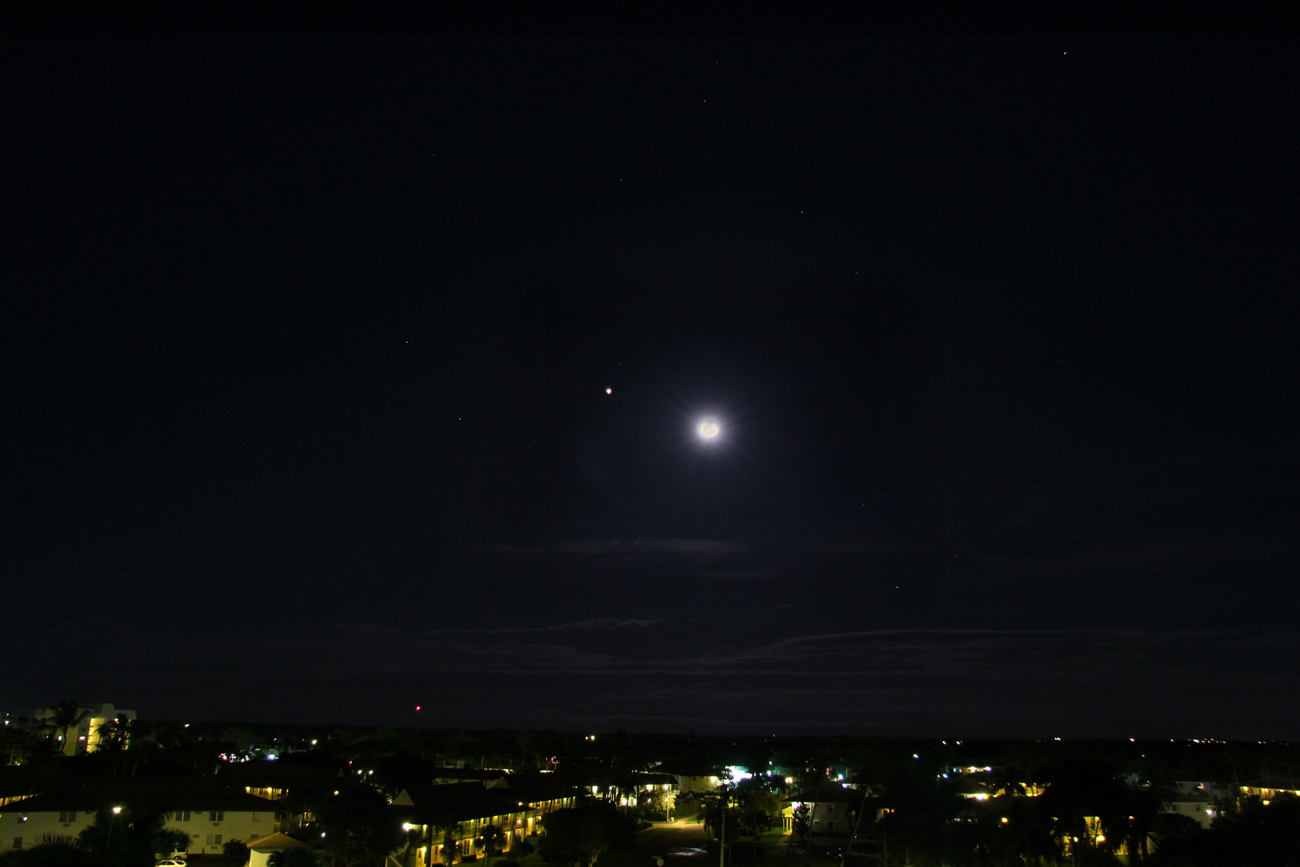 View larger. | About half a day after nightfall in the Philippines on November 21, night fell in Canada. That's where Brian McGaffney of Nutwood Observatory caught the moon and Jupiter. This image is a composite - 3 images stacked. Thank you, Brian!