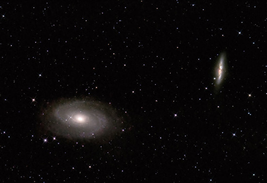 Galaxies M81 (r) and M82 as seen through a small telescope. Photo by Markus Schopfer via Wikimedia Commons.