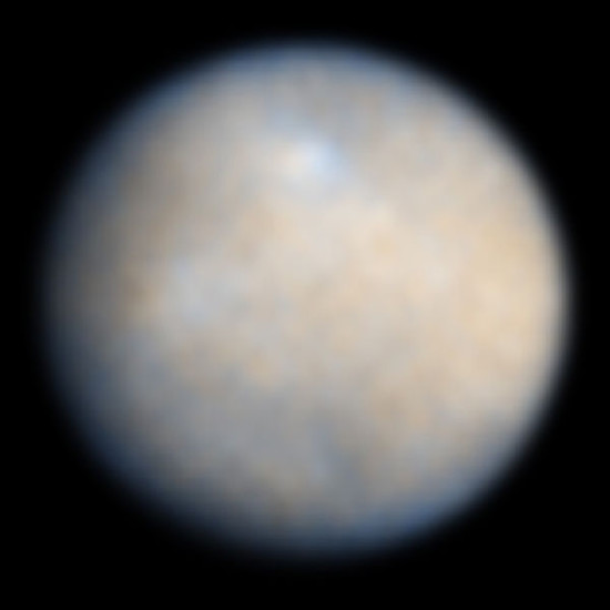 This is a NASA Hubble Space Telescope color image of Ceres, the largest object in the asteroid belt. Features on Ceres' surface include brighter and darker regions that could be asteroid impact features. These Hubble observations were made in visible and ultraviolet light between December 2003 and January 2004. Image via Hubble Space Telescope.