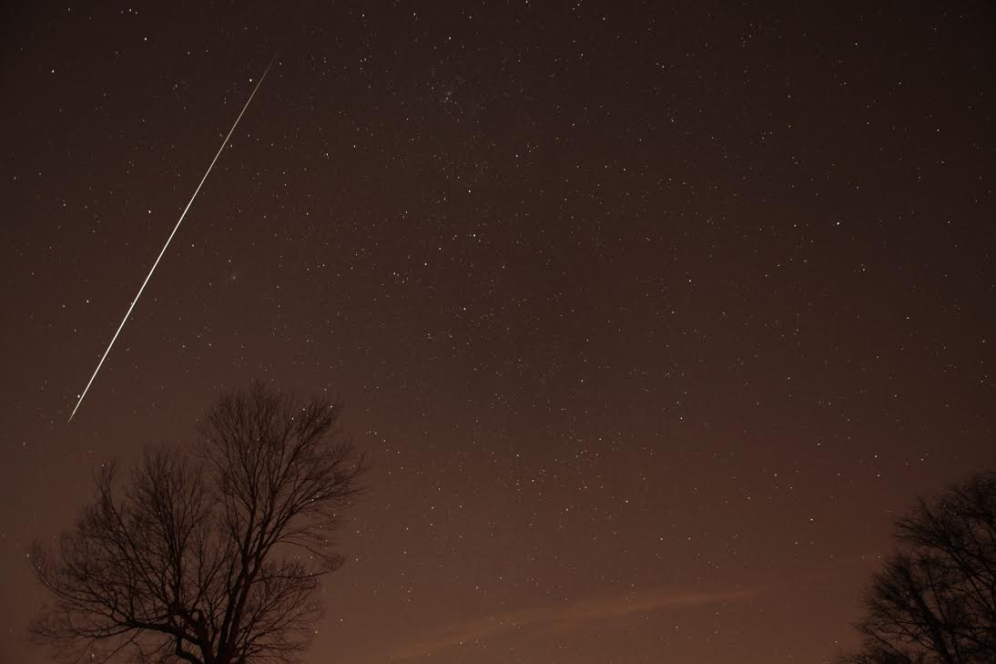 View larger. | Geminid meteor 2012 as captured by Henry Shaw of SummersMagic Photography.  Click here to learn from Henry how to take photos of meteors.