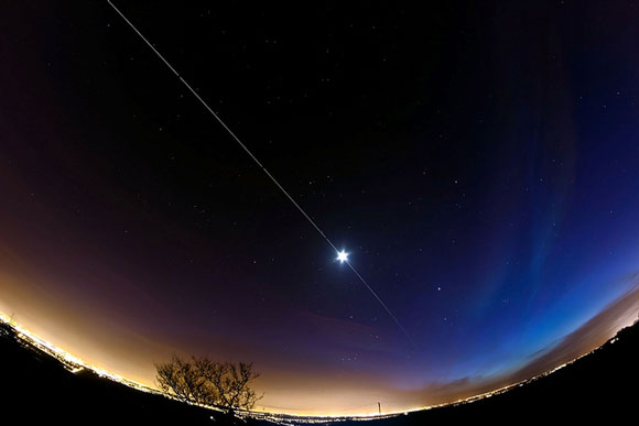 A composite photograph of the International Space Station from Earth. Image Credit: Dave Walker.
