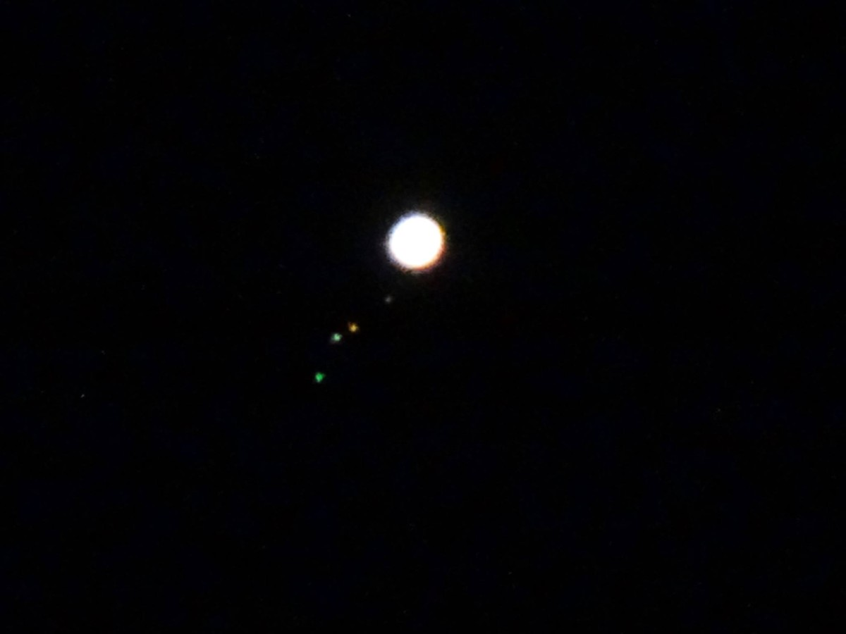 View larger. | Planet Jupiter and its four largest moons, by Carl Galloway.