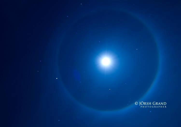 View larger. | Jorsh Grand captured this beautiful photo on December 19, 2013. The bright object on the rim of the halo is Jupiter.
