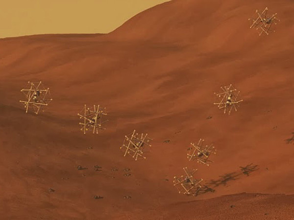 Computer-drawn image of Super Ball Bots rolling around a planet surface. Image credit: NASA Ames.