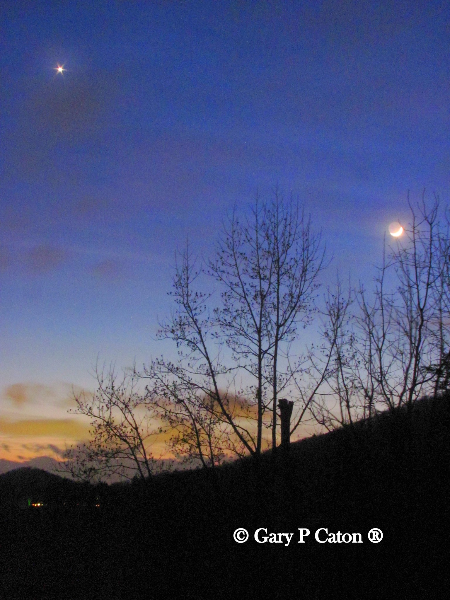 View larger. | People around the world saw the moon and Venus last night. Gary P. Caton captured them from Asheville, North Carolina. Thank you, Gary! View more photos by Gary P. Caton here.