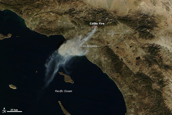 NASA's Terra satellite captured this image of the Colby fire just before noon on January 16.   Image via NASA Earth Observatory