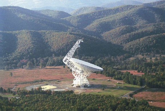 The Green Bank Telescope is about 100 yards wide and 485 feet tall, nearly as tall as the nearby mountains. It is the world's largest fully steerable radio telescope. The telescope is in a valley of the Allegheny mountains to shield the observations from radio interference. Image via Wikimedia Commons.