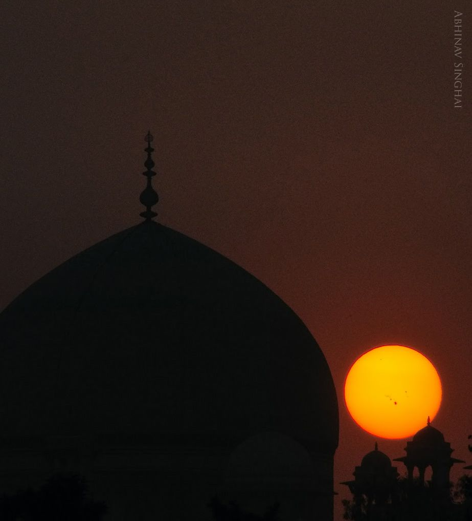 View larger. | Abhinav Singhai captured this image of Humayun's Tomb and the sunspot group AR1944 on January 8, 2014.  Thank you, Abhinav!