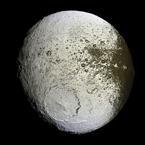 Cassini captured the first high-resolution glimpse of the bright trailing hemisphere of Saturn's moon Iapetus in this false-color mosaic from September 2007.   Read about this image at Wikimedia Commons.