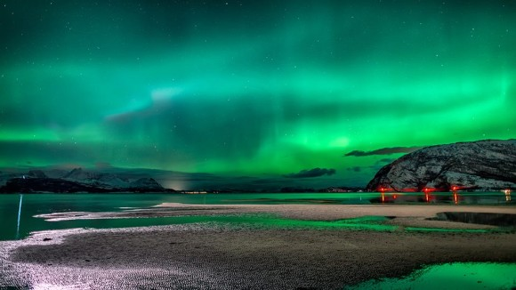 Reisafjorden, Norway bathing in auroras on January 2, 2014. Copyright 2014 Tor-Ivar Næss.