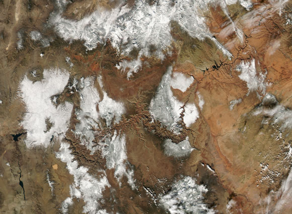 Satellite view of the Grand Canyon with snow in the surrounding area. Image Credit: NASA.