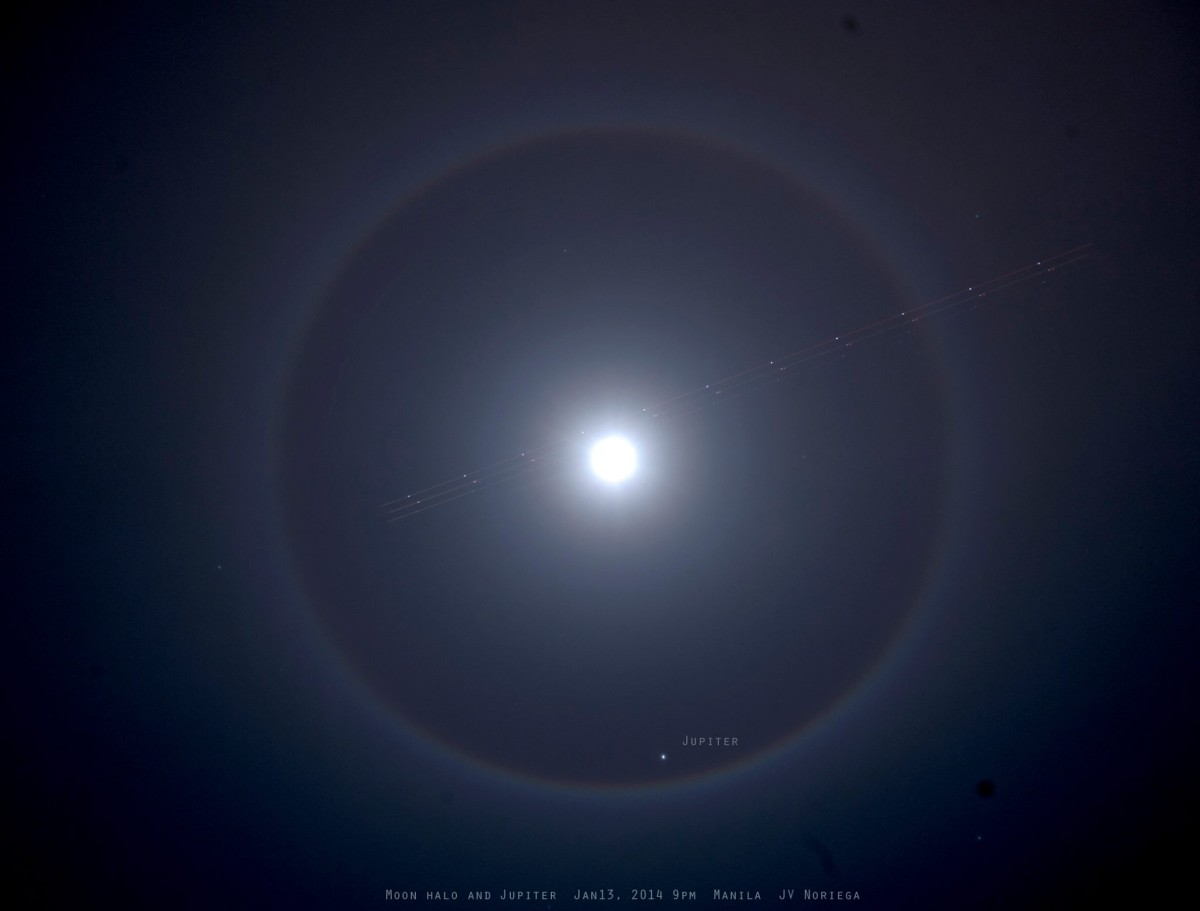 View larger. | Look up!  You might see something cool. EarthSky Facebook friend Jv Noriega in the Philippines captured this lunar halo on January 13, 2014.  Look closely.  An airliner streaks across the halo.  At the bottom of the ring is Jupiter!  011314 9pm Manila.  Thank you, Jv.  See more Jv Noriega photos