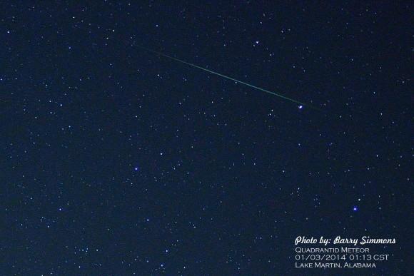 meteor streaking against background of stars
