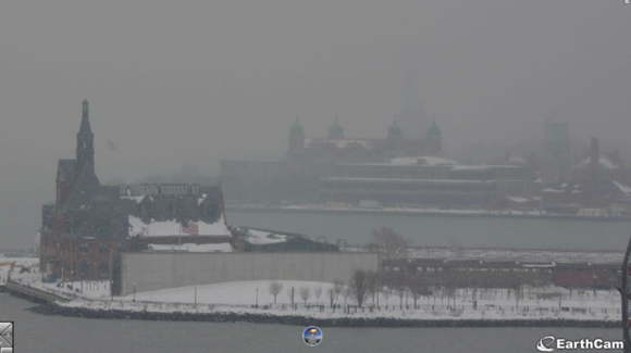 The view from Jersey City looking towards Ellis Island at 1105 am on February 15th as a light snow band overspread the region. The Statue of Liberty was barely visible in the far background. Image Credit: EarthCam via NY NWS Office