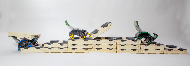 TERMES robots carry bricks, and construct staircases that they climb to add bricks to a structure. Computer algorithms specifying low-level rules are independently used by each robot in their construction project. Image credit: Eliza Grinnell, SEAS Communications, Harvard University.