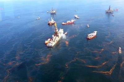This image, taken on May 20, 2010, about a month after the initial Deepwater Horizon Oil Spill in the Gulf of Mexico, shows cleanup efforts near the source of the spill. Image Credit: NOAA.