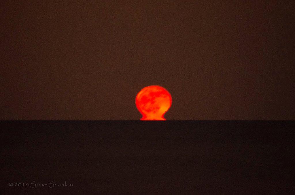 View larger.  | Moonset via Steve Scanlon Photography.  Visit Steve Scanlon Photography on Facebook.