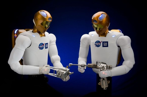 MIT didn't release this picture.  It came from Wikimedia Commons.  But MIT is doing research in robotics to enable robots to work together.