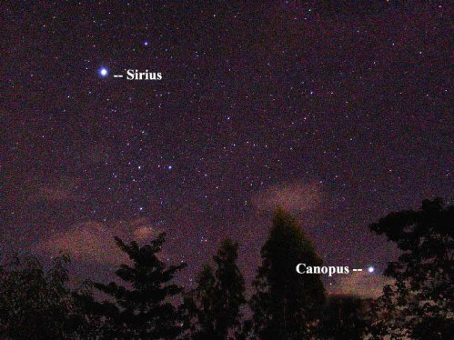 If you are far enough south on Earth's globe, you can see the sky's second-brightest star, Canopus, below the sky's brightest star, Sirius.  Photo taken by Jun Lao of the Philippines on December 29, 2005.
