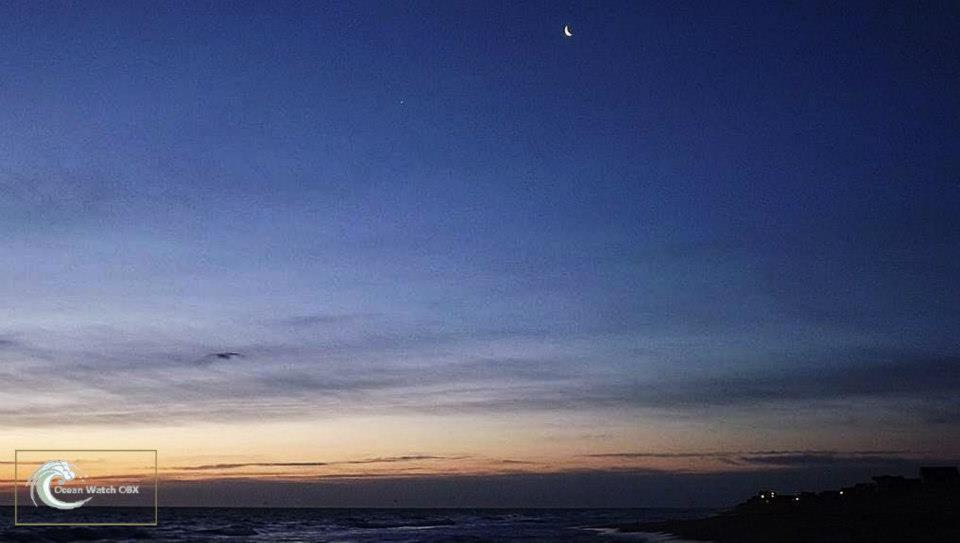 View larger. | EarthSky Facebook friend Ocean Watch OBX caught this photo of the moon and Venus over the ocean on February 25.