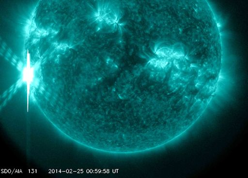 X-flare of February 24-25, 2014.  NASA's Solar Dynamics Observatory recorded the extreme ultraviolet flash.  Image via Spaceweather.com