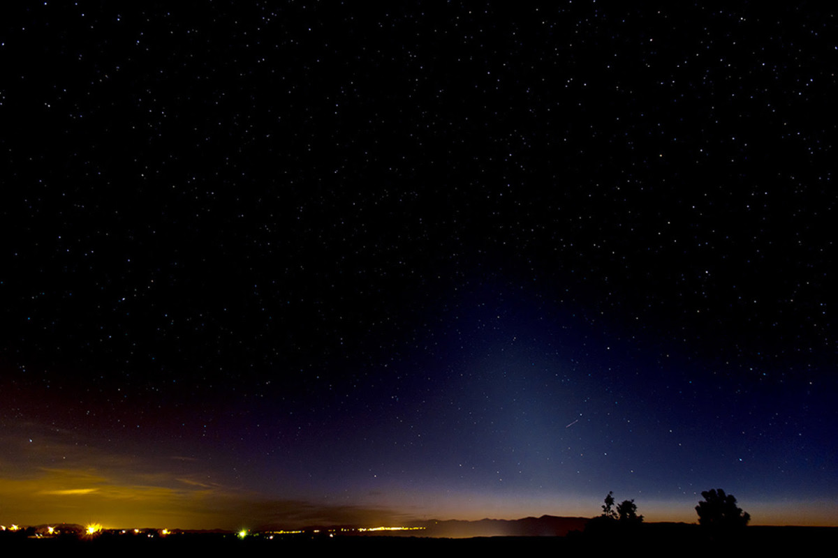 View larger. | The zodiacal lights are the diffuse cone-shaped lights extending up from the horizon on the right side of this photo.   Richard T. Hasbrouck in Truchas, New Mexico. captured this photo on February 23, 2014.