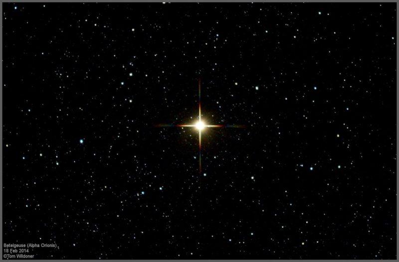 Golden star in dark sky.