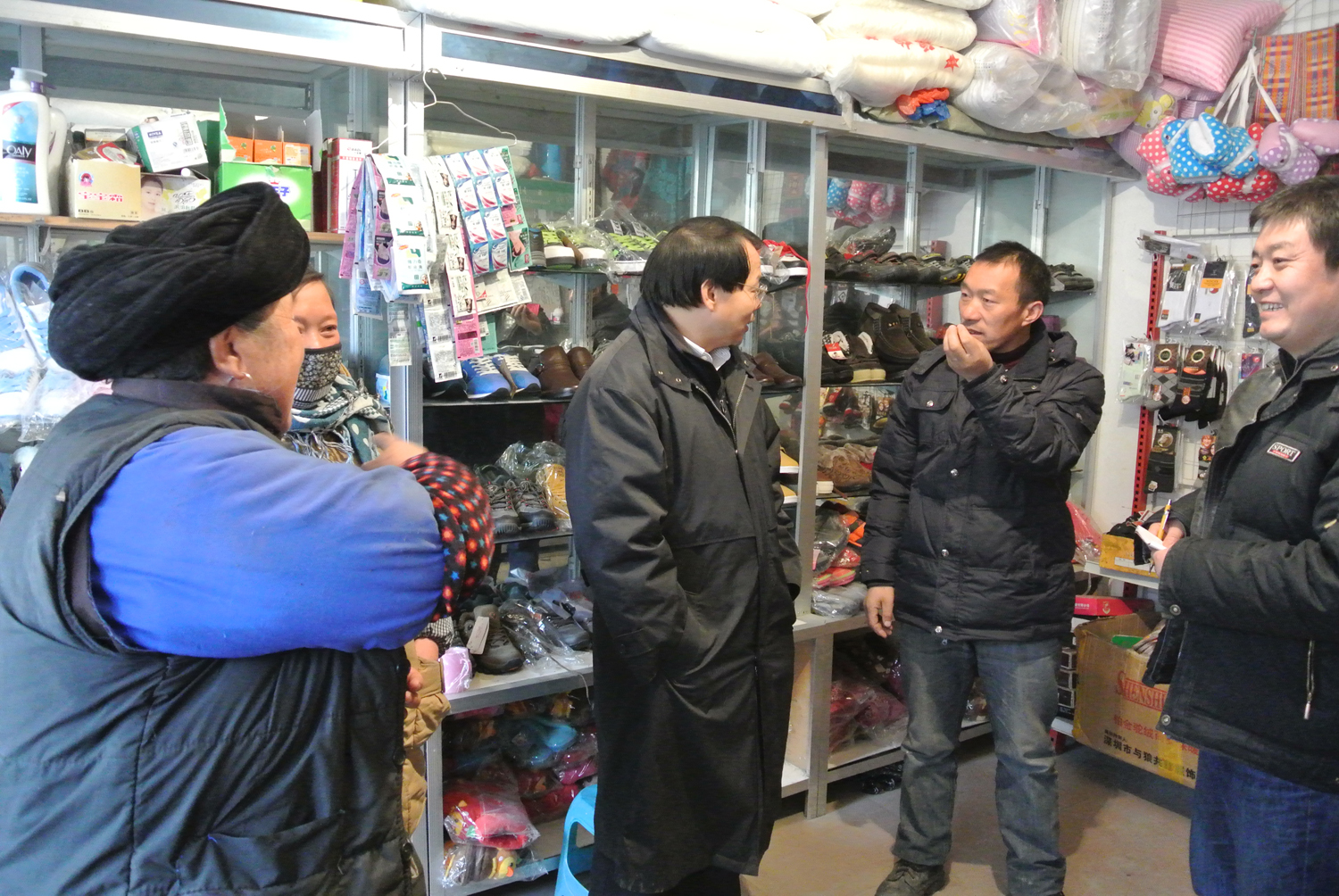 Two of the paper co-authors, Jack Liu (left) and Jindong Zhang are seen here talking to a farmer about the impact of livestock on panda habitat at the Wolong Nature Reserve. Image courtesy of Michigan State University.
