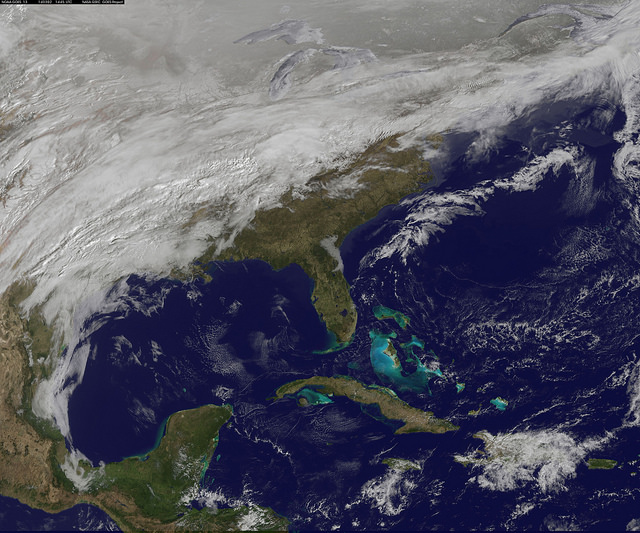 Cloud data from NOAA's GOES-East satellite were overlaid on a true-color image of land and ocean created by data from the MODIS instrument that flies aboard NASA's Aqua and Terra satellites. Together, those data created the entire picture of the position of this major winter storm on March 2, 2014.  Image via Rob Gutro/ NASA Goddard Space Flight Center, Greenbelt, Md.