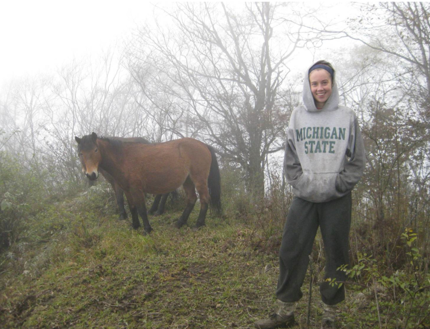 Vanessa Hull with one of the horses found grazing on bamboo at Wolong Nature Reserve. Image courtesy of Michigan State University.