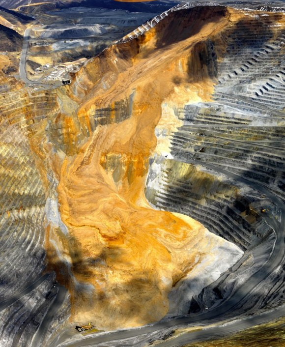 The April 10, 2013, landslide at Bingham Canyon mine contained enough debris to bury New York City's Central Park 66 feet deep, according to a new University of Utah study. The slide happened in the form of two rock avalanches 95 minutes apart. The first rock avalanche included grayer bedrock material seen around the margins of the lower half of the slide. The second rock avalanche is orange in color, both from bedrock and from waste rock from mining. The landslide also triggered 16 small earthquakes. Photo by Kennecott Utah Copper, via University of Utah.