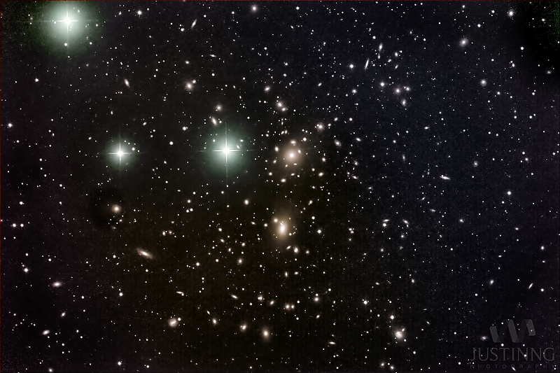 What appears to be a densely populated star field with a few galaxies visible.