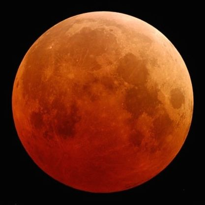 Full moon, dark red in color.