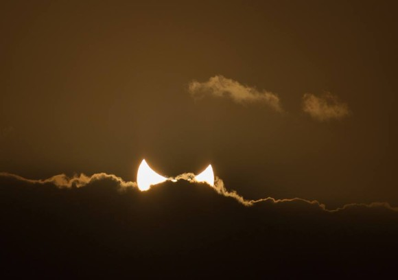 Sunset solar eclipse on April 29, 2014 as captured by Colin Legg.  Visit Colin Legg Photography on Facebook.
