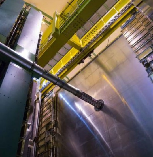 A view of the LHCb experiment at underground Point 8 on the Large Hadron Collider (LHC). The prominent tube is the LHC beam pipe, in which protons circulate at close to the speed of light. Photo credit: Anna Pantelia/CERN
