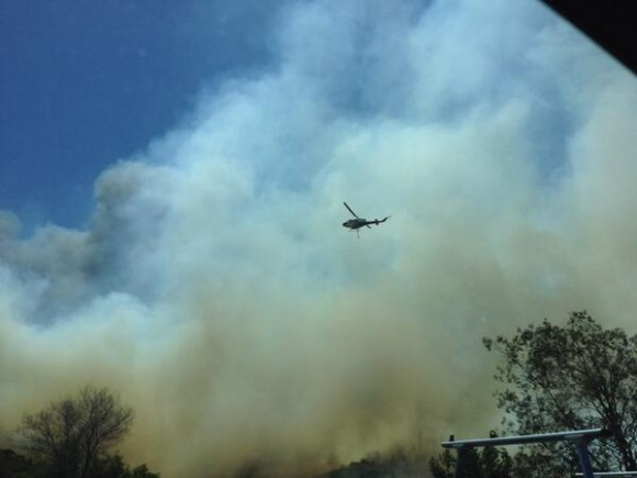 Fire fighters combating the flames from the air in Carlsbad. Image Credit: Justin Molitta
