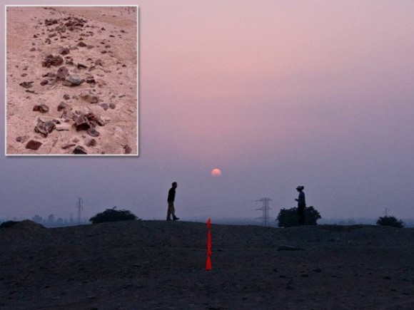 A winter solstice sunset on the largest Paracas mound in Peru. Meter-wide geoglyphs (inset) guided travelers to such places to celebrate.  Photo via sciencemag.org and Charles Stanish.