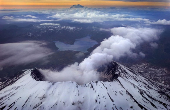 Views of Mount St Helens looking North with Mount Rainier and Spirit Lake in the background on the evening of May 3, 2005. That is steam coming from the mountain.  Photo by Bruce Ely/The Oregonian via OregonLive.